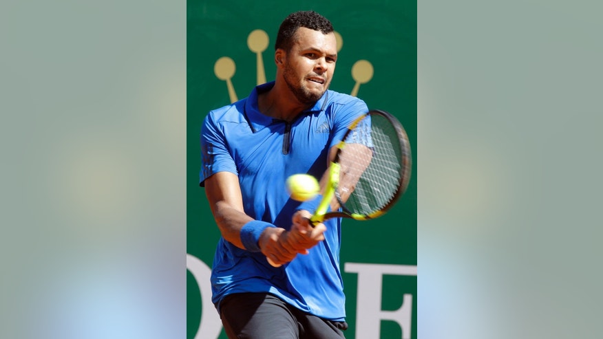 France's Jo-Wilfried Tsonga plays a return to Swiss Roger Federer during their quarter final match of the Monte Carlo Tennis Masters tournament in Monaco, Friday, April 15, 2016. (AP Photo/Lionel Cironneau)