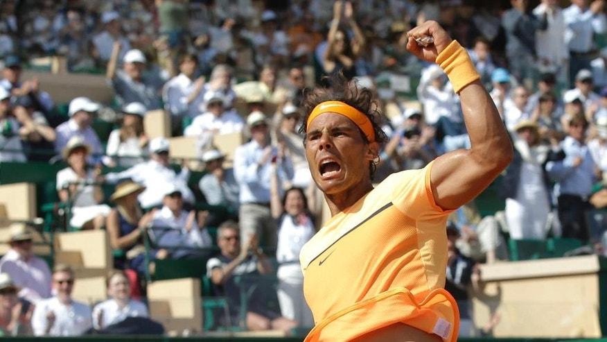 Spain's Rafael Nadal reacts after defeating  Andy Murray of Great Britain during their semi final match of the Monte Carlo Tennis Masters tournament in Monaco, Saturday, April 16, 2016. (AP Photo/Lionel Cironneau)