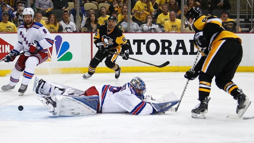 Pittsburgh Penguins' Phil Kessel (81) puts the puck past a sprawling New York Rangers goalie Henrik Lundqvist (30) for a goal during the second period in Game 2 in the first round of the NHL Stanley Cup playoffs in Pittsburgh, Saturday, April 16, 2016. (AP Photo/Gene J. Puskar)