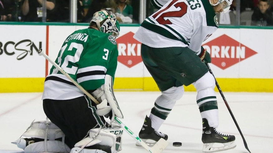 Dallas Stars goalie Kari Lehtonen (32) defends the goal against Minnesota Wild right wing David Jones (12) during the second period in Game 2 in the first round of the NHL Stanley Cup playoffs Saturday, April 16, 2016, in Dallas. (AP Photo/LM Otero)