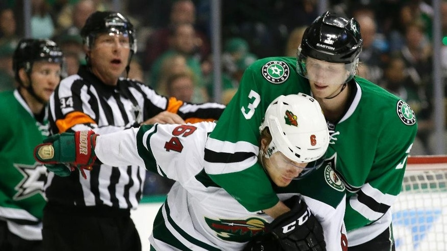 Minnesota Wild center Mikael Granlund (64) and Dallas Stars defenseman John Klingberg (3) tangle during the second period in Game 2 in the first round of the NHL Stanley Cup playoffs Saturday, April 16, 2016, in Dallas. (AP Photo/LM Otero)