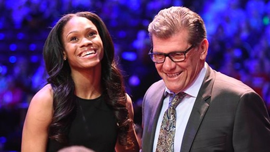 Connecticut's Moriah Jefferson smiles after being congratulated by UConn coach Geno Auriemma, right, after the San Antonio Stars selected Jefferson with the second pick in theWNBA basketball draft, Thursday, April 14, 2016, in Uncasville, Conn. (Cloe Poisson/Hartford Courant via AP) MANDATORY CREDIT