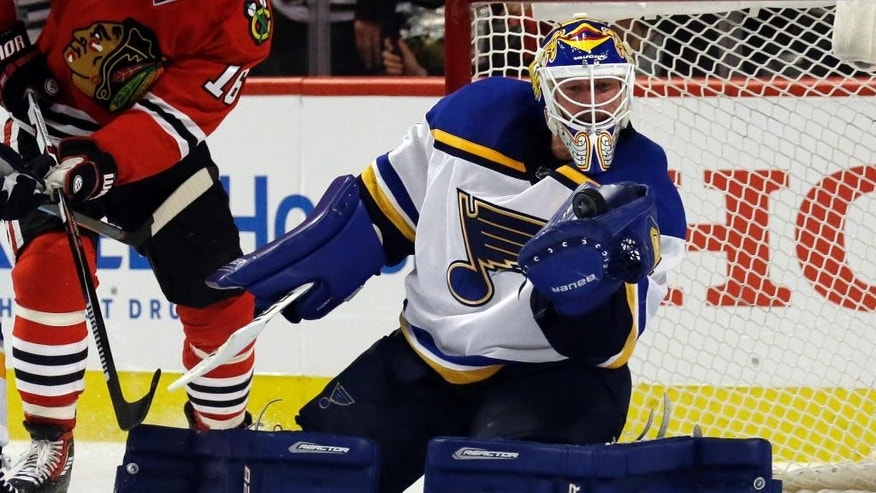 St. Louis Blues goalie Brian Elliott makes a save during the second period in Game 3 of an NHL hockey first-round Stanley Cup playoff series against the Chicago Blackhawks, Sunday, April 17, 2016, in Chicago. (AP Photo/Nam Y. Huh)