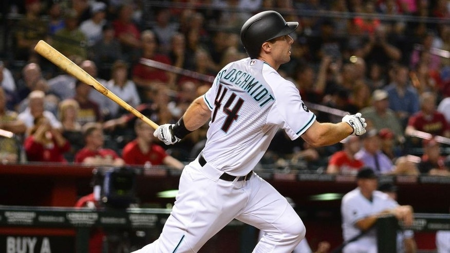 Apr 5, 2016; Phoenix, AZ, USA; Arizona Diamondbacks first baseman Paul Goldschmidt (44) triples to deep right field driving in three run against the Colorado Rockies in the seventh inning at Chase Field. Mandatory Credit: Jennifer Stewart-USA TODAY Sports