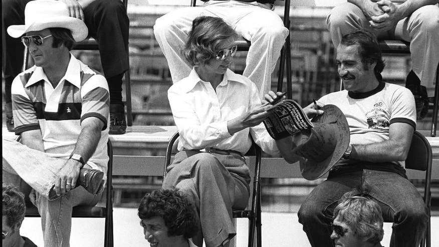 FILE - In this May 28, 1977 file photo, Janet Guthrie, center, sits between Bill Vukovich, left, and Clay Regazzoni, during a drivers meeting for the 61st Indianapolis 500 auto race at Indianapolis Motor Speedway in Indianapolis, Ind. Guthrie is the first female driver to enter the Indianapolis 500.  (AP Photo/File)