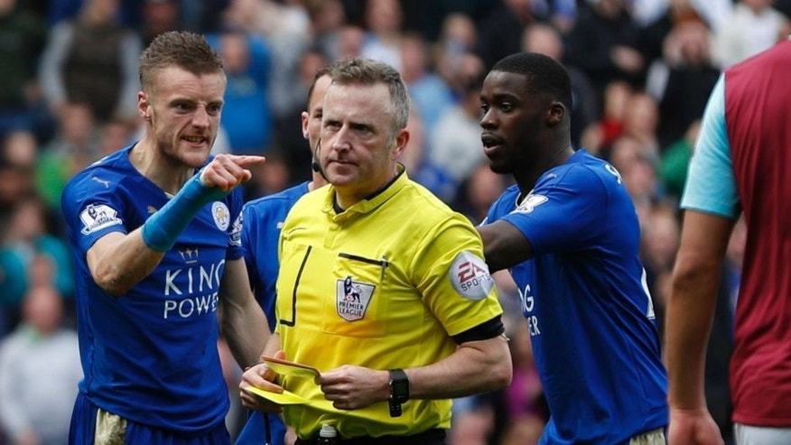 Leicester City's English striker Jamie Vardy (L) reacts after referee Jonathan Moss (2L) showed Vardy his second yellow card for simulation to send him off during the English Premier League football match between Leicester City and West Ham United at King Power Stadium in Leicester, central England on April 17, 2016. / AFP / ADRIAN DENNIS / RESTRICTED TO EDITORIAL USE. No use with unauthorized audio, video, data, fixture lists, club/league logos or 'live' services. Online in-match use limited to 75 images, no video emulation. No use in betting, games or single club/league/player publications. / (Photo credit should read ADRIAN DENNIS/AFP/Getty Images)