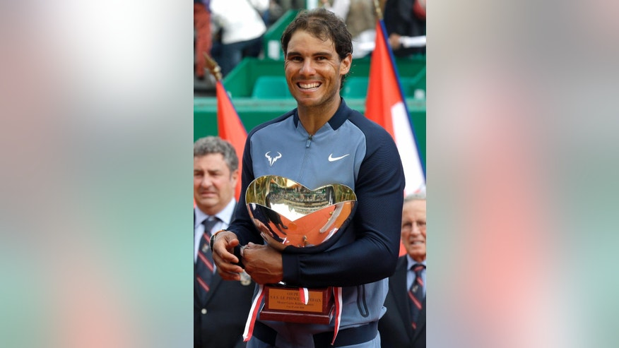 Spain's Rafael Nadal holds his cup after defeating France's Gael Monfils, in their final match of the Monte Carlo Tennis Masters tournament in Monaco, Sunday, April 17, 2016. (AP Photo/Lionel Cironneau)