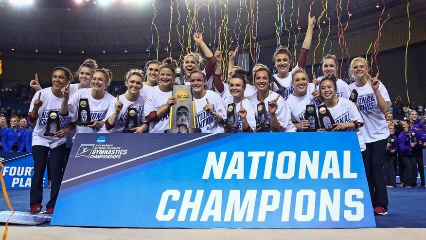Apr 16, 2016; Fort Worth, TX, USA; Oklahoma Sooners celebrate with the national championship trophy after the team finals of the 2016 NCAA Women's Gymnastics Championships at Fort Worth Convention Center Arena. Mandatory Credit: Kevin Jairaj-USA TODAY Sports