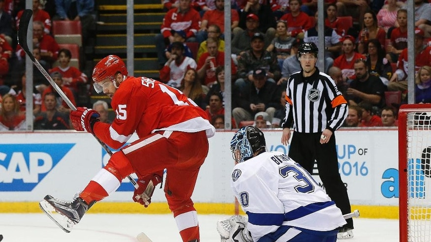 Detroit Red Wings center Riley Sheahan (15) moves for a shot while screening Tampa Bay Lightning goalie Ben Bishop (30) in the second period of Game 3 in a first-round NHL hockey Stanley Cup playoff series, Sunday, April 17, 2016, in Detroit. (AP Photo/Paul Sancya)