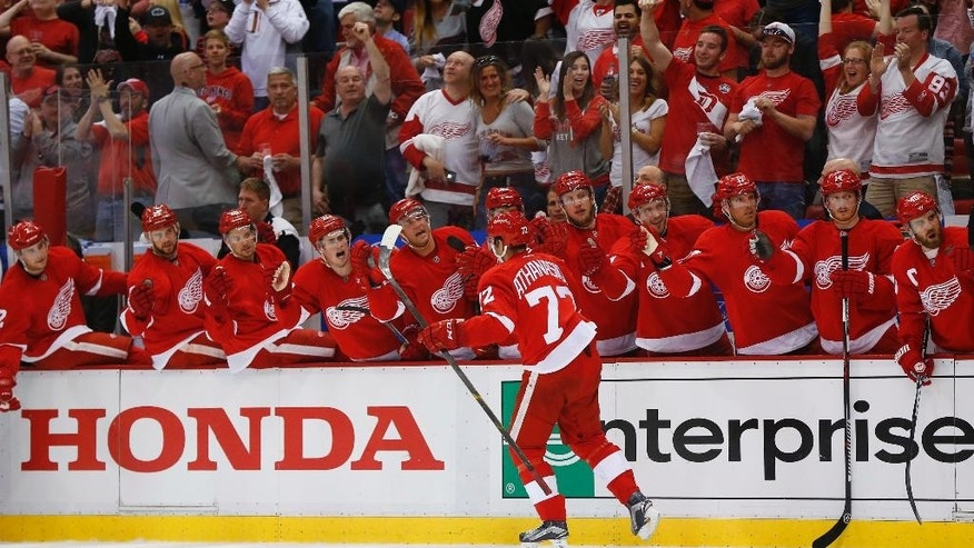 Detroit Red Wings center Andreas Athanasiou (72) celebrates his goal against the Tampa Bay Lightning in the second period of Game 3 in a first-round NHL hockey Stanley Cup playoff series, Sunday, April 17, 2016, in Detroit. (AP Photo/Paul Sancya)