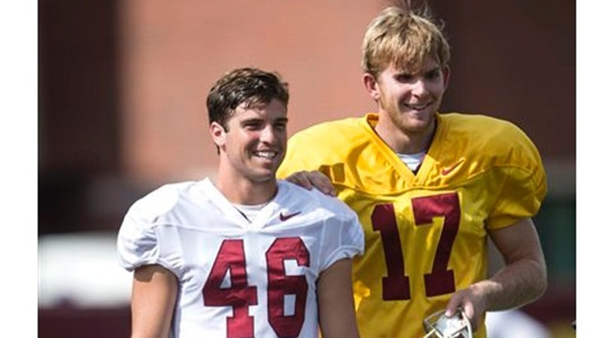 In this Sept. 15, 2015, file photo, Reid Budrovich, left, guides teammate Jake Olson, through the field during Southern California football practice in Los Angeles. (Ed Crisostomo/The Orange County Register via AP)