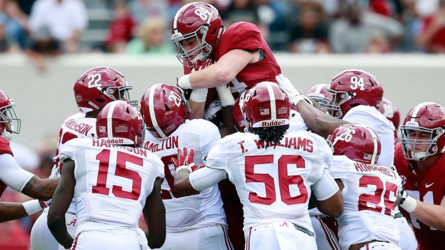 Apr 16, 2016; Tuscaloosa, AL, USA; Alabama Crimson Tide tight end Hale Hentges (84) is tackled a the defense during the annual A-day game at Bryant-Denny Stadium. Mandatory Credit: Marvin Gentry-USA TODAY Sports