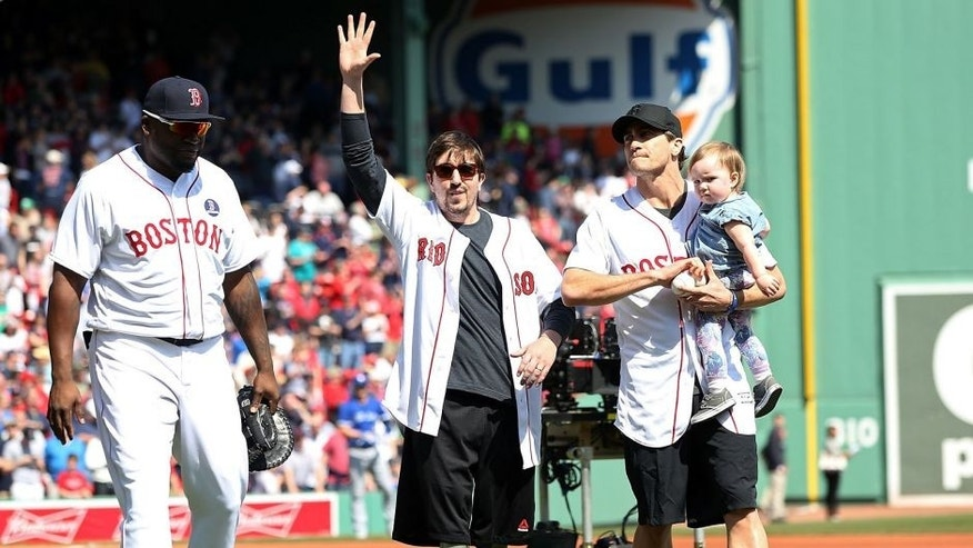 BOSTON, MA - APRIL 18: Boston Marathon bombing survivor Jeff Bauman and actor/producer Jake Gyllenhaal throw out the first pitch before the Boston Red Sox take on the Toronto Blue Jays at Fenway Park on April 18, 2016 in Boston, Massachusetts. (Photo by Adam Glanzman/Getty Images)