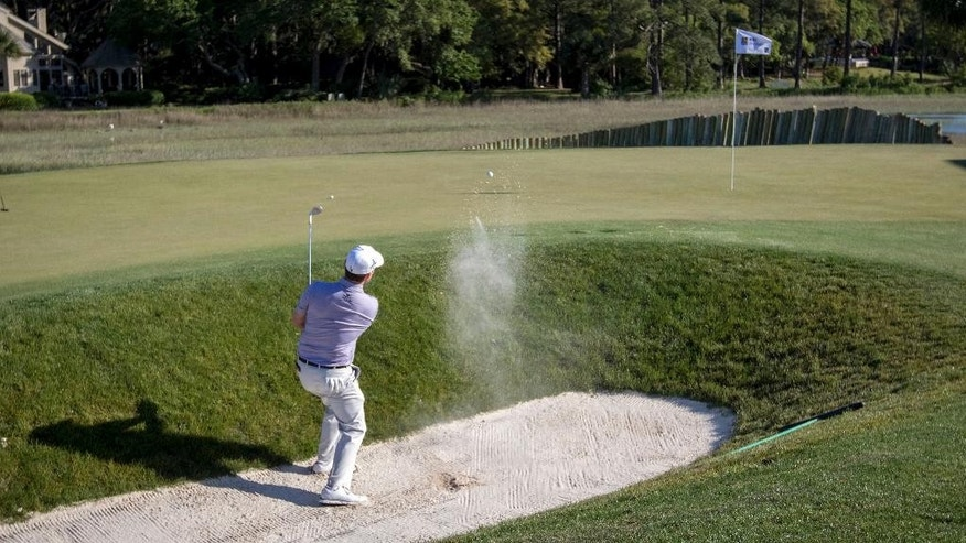 Branden Grace, of South Africa, hits out of the bunker on the 17th green during the final round of the RBC Heritage golf tournament in Hilton Head Island, S.C., Sunday, April 17, 2016. (AP Photo/Stephen B. Morton)