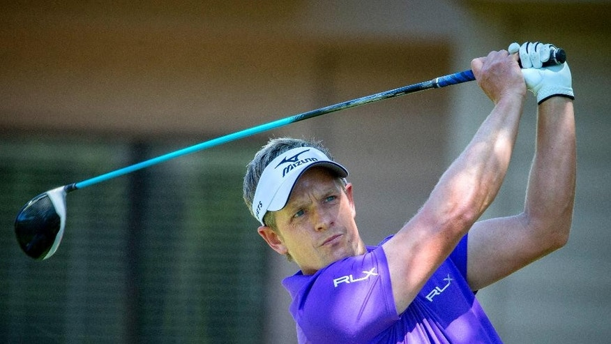 Luke Donald, of England, watches his drive down the third fairway during the final round of the RBC Heritage golf tournament in Hilton Head Island, S.C., Sunday, April 17, 2016. (AP Photo/Stephen B. Morton)