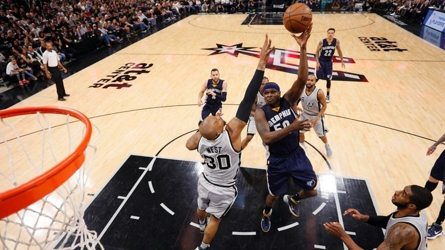 Apr 17, 2016; San Antonio, TX, USA; Memphis Grizzlies power forward Zach Randolph (50) shoots the ball over San Antonio Spurs power forward David West (30) during the first half in game one of the first round of the NBA Playoffs at AT&T Center. Mandatory Credit: Soobum Im-USA TODAY Sports