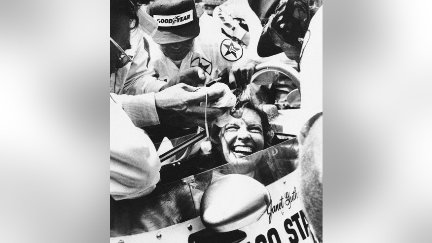 FILE - In this May 28, 1978 file photo, Janet Guthrie is all smiles as her pit crew swarms around her following the 62nd running of the Indianapolis 500 auto race in Indianapolis, Ind. Guthrie became first woman ever to finish in the Memorial Day Classic. (AP Photo/File)