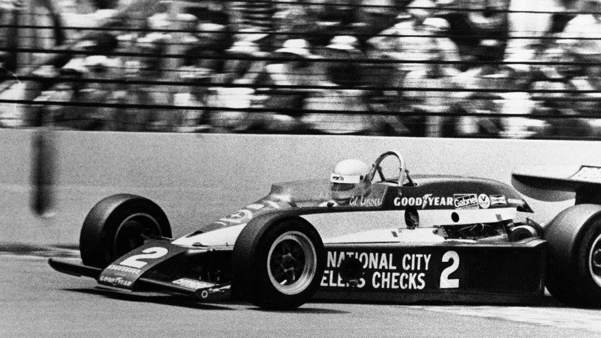 FILE - In this May 28, 1978 file photo, Al Unser crosses the finish line to win the 62nd running of the Indianapolis 500 auto race at Indianapolis Motor Speedway in Indianapolis, Ind.  (AP Photo/File)