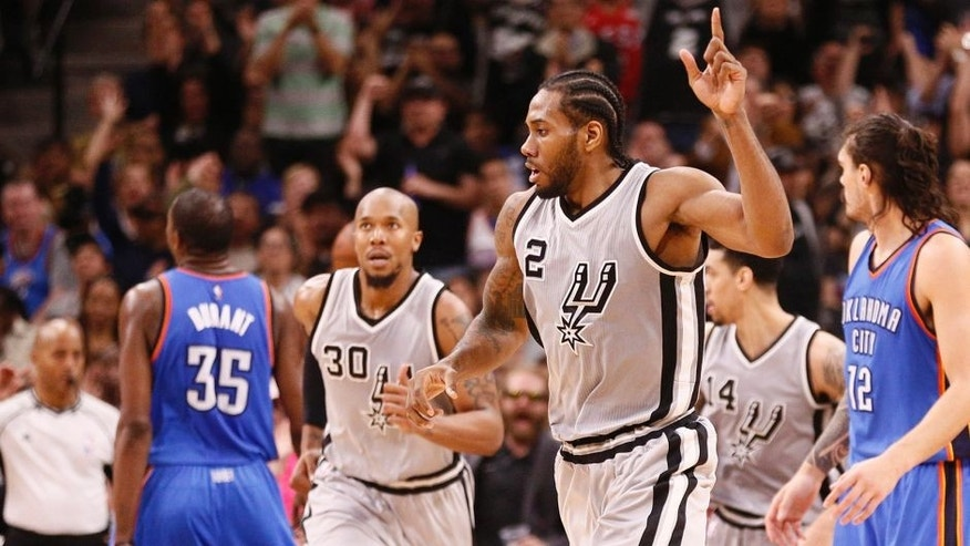 Mar 12, 2016; San Antonio, TX, USA; San Antonio Spurs small forward Kawhi Leonard (2) reacts after a shot against the Oklahoma City Thunder during the second half at AT&T Center. Mandatory Credit: Soobum Im-USA TODAY Sports