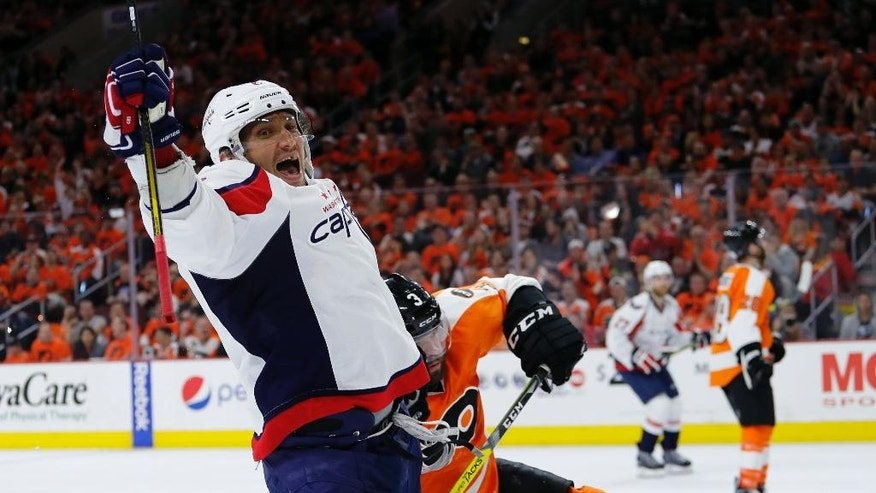 Washington Capitals' Alex Ovechkin, left, celebrates past Philadelphia Flyers' Radko Gudas after scoring a goal during the second period of Game 3 in the first round of the NHL Stanley Cup hockey playoffs, Monday, April 18, 2016, in Philadelphia. (AP Photo/Matt Slocum)