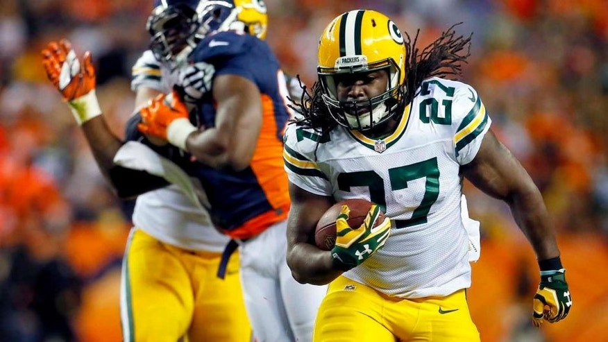 Sunday, Nov. 1: Green Bay Packers running back Eddie Lacy runs for a touchdown against the Denver Broncos during the first half in Denver.