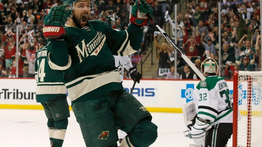 Minnesota Wild left wing Chris Porter (7) celebrates after scoring on Dallas Stars goalie Kari Lehtonen (32) during the first period of Game 3 in the first round of the NHL Stanley Cup playoffs in St. Paul, Minn., Monday, April 18, 2016. (AP Photo/Ann Heisenfelt)