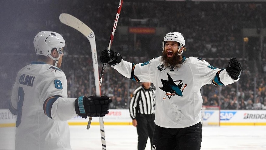 San Jose Sharks center Joe Pavelski, left, celebrates his goal with defenseman Brent Burns during the first period of Game 2 in an NHL hockey Stanley Cup playoffs first-round series against the Los Angeles Kings, Saturday, April 16, 2016, in Los Angeles. (AP Photo/Mark J. Terrill)