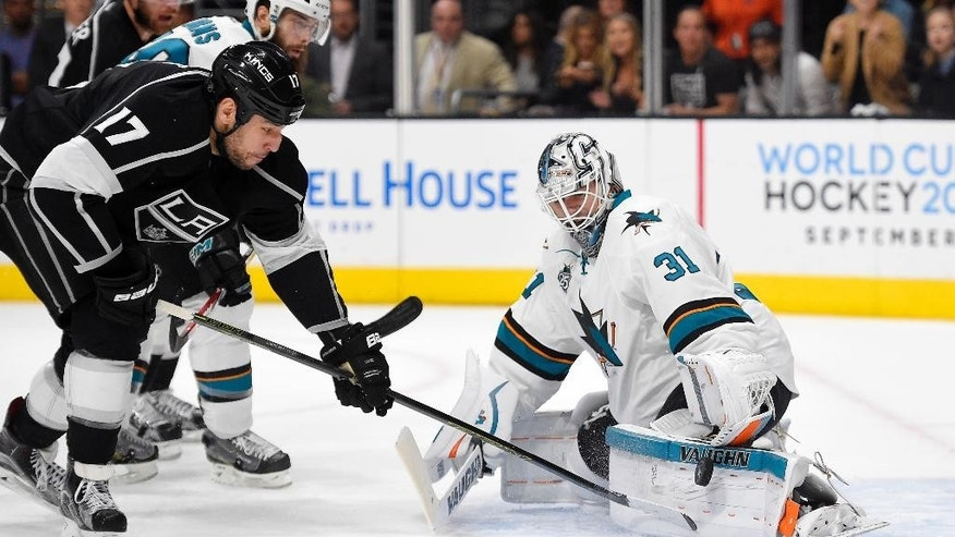 San Jose Sharks goalie Martin Jones, right, stops a shot by Los Angeles Kings left wing Milan Lucic during the second period of Game 2 in an NHL hockey Stanley Cup playoffs first-round series, Saturday, April 16, 2016, in Los Angeles. (AP Photo/Mark J. Terrill)