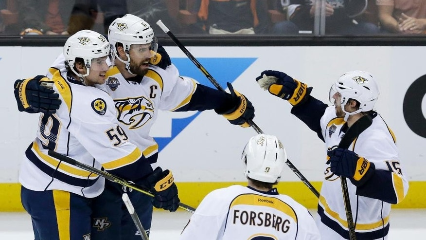 Nashville Predators defenseman Shea Weber (6) celebrates after scoring with teammates during the second period of Game 2 of an NHL hockey first-round Stanley Cup playoff series against the Anaheim Ducks in Anaheim, Calif., Sunday, April 17, 2016. (AP Photo/Chris Carlson)