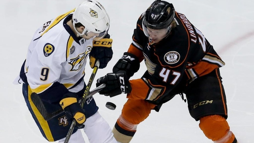 Anaheim Ducks defenseman Hampus Lindholm, right, battles Nashville Predators center Filip Forsberg for the puck during the second period of Game 2 in an NHL hockey Stanley Cup playoffs first-round series in Anaheim, Calif., Sunday, April 17, 2016. (AP Photo/Chris Carlson)