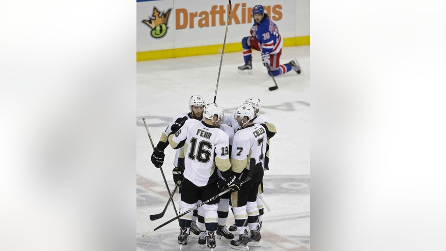 Pittsburgh Penguins Eric Fehr (16) and Matt Cullen (7) celebrate a goal by Kris Letang as New York Rangers' Mats Zuccarello (36) watches during the third period of Game 3 of a first-round NHL playoff hockey series Tuesday, April 19, 2016, in New York. The Penguins won 3-1. (AP Photo/Frank Franklin II)