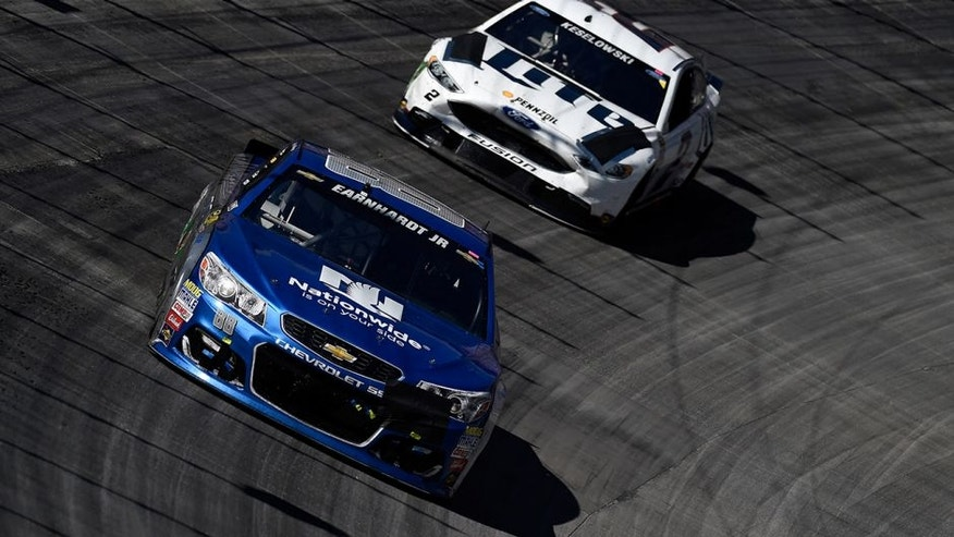 BRISTOL, TN - APRIL 17: Dale Earnhardt Jr., driver of the #88 Nationwide Chevrolet, leads Brad Keselowski, driver of the #2 Miller Lite Ford, during the NASCAR Sprint Cup Series Food City 500 at Bristol Motor Speedway on April 17, 2016 in Bristol, Tennessee. (Photo by Rainier Ehrhardt/NASCAR via Getty Images)