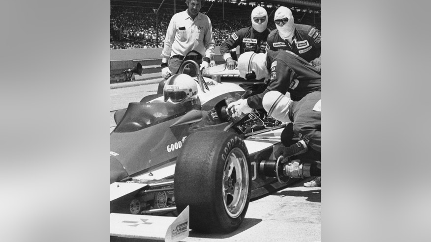 FILE - In this May 27, 1979 file photo, pit crewmen refuel Rick Mears' car on the 196th lap of the 63rd running of the Indianapolis 500 auto race in Indianapolis, Ind. (AP Photo/File)