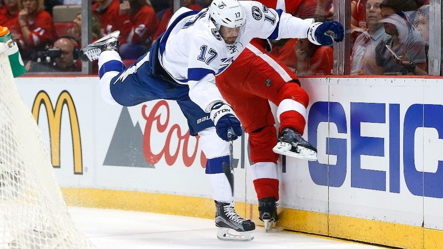 Tampa Bay Lightning center Alex Killorn (17) checks Detroit Red Wings defenseman Niklas Kronwall (55) in the first period of Game 3 in a first-round NHL hockey Stanley Cup playoff series, Sunday, April 17, 2016, in Detroit. (AP Photo/Paul Sancya)