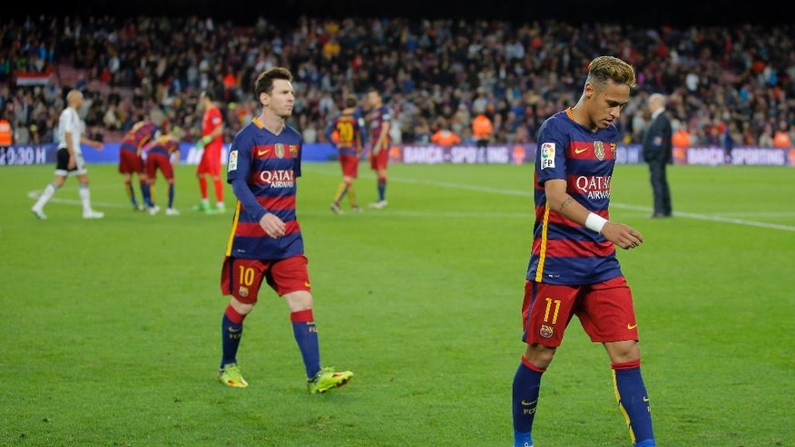 FC Barcelona's Neymar, right, and Lionel Messi leave the pitch at the end of a Spanish La Liga soccer match between FC Barcelona and Valencia at the Camp Nou stadium in Barcelona, Spain, Sunday, April 17, 2016. FC Barcelona lost the match 1-2. (AP Photo/Manu Fernandez)