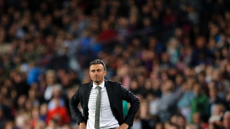 FC Barcelona's head coach Luis Enrique looks on during a Spanish La Liga soccer match between FC Barcelona and Valencia at the Camp Nou stadium in Barcelona, Spain, Sunday, April 17, 2016. FC Barcelona lost the match 1-2. (AP Photo/Manu Fernandez)