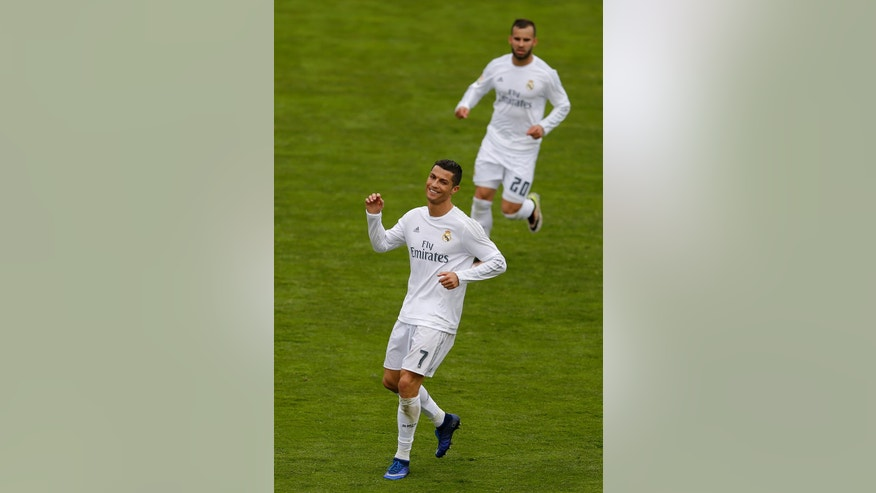 Real Madrid's Cristiano Ronaldo smiles after scoring his side's fifth goal against Getafe during a Spanish La Liga soccer match between Real Madrid and Getafe at the Alfonso Perez stadium in Getafe, near Madrid, Saturday, April 16, 2016. Ronaldo scored once in Real Madrid's 5-1 victory. (AP Photo/Francisco Seco)