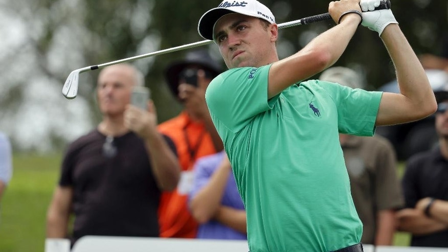 FILE - In this March 2, 2016, file photo, Justin Thomas tees off from the 11th hole practice round of the Cadillac Championship golf tournament in Doral, Fla. Thomas was coming off a strong rookie year in 2015, contending a half-dozen times before breaking through for his first PGA Tour victory in Malaysia in October. But then he started the new year in a rut, and he knew just what to do, no matter how awkward it might have seemed. He asked Jack Nicklaus if he could come over to his house to talk. (AP Photo/Lynne Sladky, File)