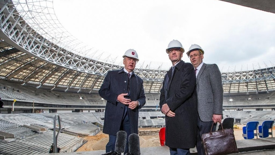 FIFA President Gianni Infantino, center, listens to Moscow's Mayor Sergei Sobyanin, left, at the Luzhniki Stadium which is undergoing a major rebuild to be ready for the 2018 World Cup, in Moscow, Russia, Tuesday, April 19, 2016. Others are unidentified officials. Gianni Infantino is visiting 2018 World Cup host Russia for the first time since he was elected FIFA president in February. (AP Photo/Alexander Zemlianichenko)