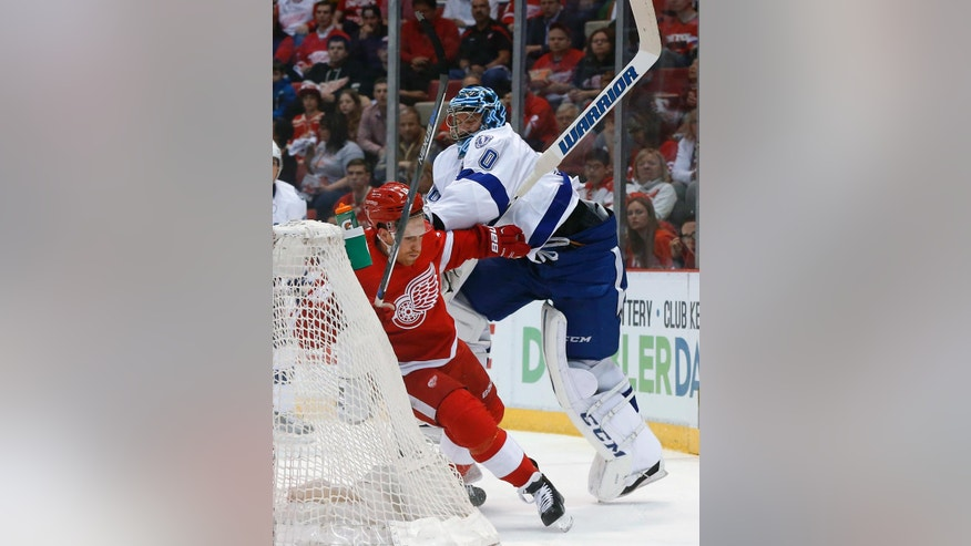 Tampa Bay Lightning goalie Ben Bishop (30) checks Detroit Red Wings center Joakim Andersson during the first period of Game 4 in a first-round NHL hockey Stanley Cup playoff series, Tuesday, April 19, 2016, in Detroit. (AP Photo/Paul Sancya)