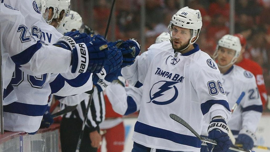 Tampa Bay Lightning's Nikita Kucherov (86) celebrates his goal against the Detroit Red Wings during the first period of Game 4 in a first-round NHL hockey Stanley Cup playoff series, Tuesday, April 19, 2016, in Detroit. (AP Photo/Paul Sancya)