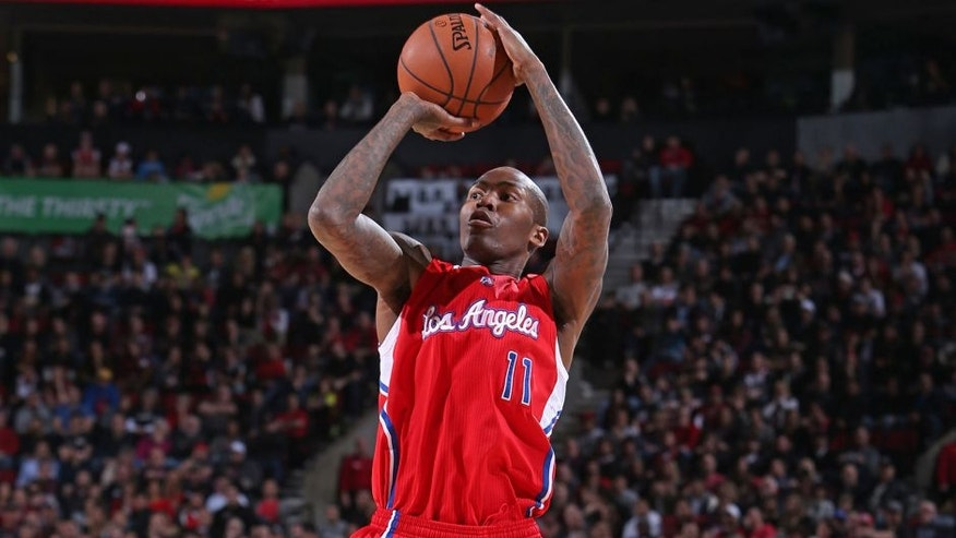 PORTLAND, OR - JANUARY 14: Jamal Crawford #11 of the Los Angeles Clippers shoots the ball against the Portland Trail Blazers during the game on January 14, 2015 at the Moda Center in Portland, Oregon. NOTE TO USER: User expressly acknowledges and agrees that, by downloading and or using this Photograph, user is consenting to the terms and conditions of the Getty Images License Agreement. Mandatory Copyright Notice: Copyright 2015 NBAE (Photo by Sam Forencich/NBAE via Getty Images)