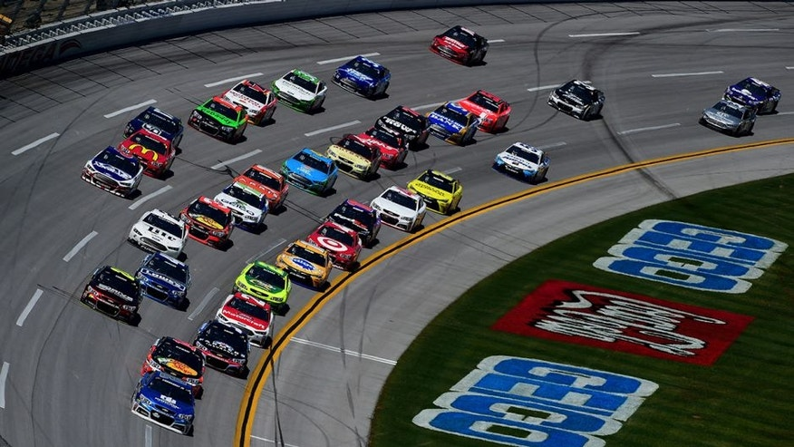 TALLADEGA, AL - MAY 03: Dale Earnhardt Jr., driver of the #88 Nationwide Chevrolet, leads a pack of cars during the NASCAR Sprint Cup Series GEICO 500 at Talladega Superspeedway on May 3, 2015 in Talladega, Alabama. (Photo by Jared C. Tilton/Getty Images)