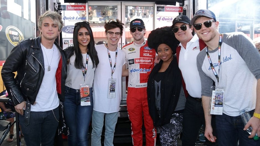 FONTANA, CA - MARCH 20: Ryan Blaney, driver of the #21 Motorcraft/Quick Lane Tire & Auto Center Ford, takes a photo with American Idol contestants MacKenzie Bourg, LaíPorsha Renae, Dalton Rapattoni, Trent Harmon, Sonika Vaid, and President and Ceo of Big Machine Records Scott Borchetta on the grid during the NASCAR Sprint Cup Series Auto Club 400 at Auto Club Speedway on March 20, 2016 in Fontana, California. (Photo by Jeff Gross/Getty Images)