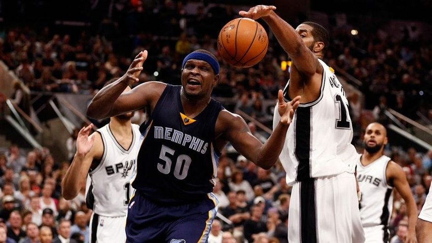 Apr 19, 2016; San Antonio, TX, USA; Memphis Grizzlies power forward Zach Randolph (50) has his shot blocked by San Antonio Spurs power forward LaMarcus Aldridge (12, right) in game two of the first round of the NBA Playoffs at AT&T Center. Mandatory Credit: Soobum Im-USA TODAY Sports