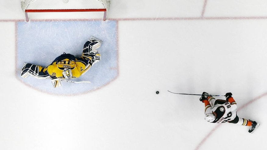 Anaheim Ducks left wing Jamie McGinn (88) scores against Nashville Predators goalie Pekka Rinne (35), of Finland, in the first period of Game 3 in an NHL hockey first-round Stanley Cup playoff series Tuesday, April 19, 2016, in Nashville, Tenn. (AP Photo/Mark Humphrey)
