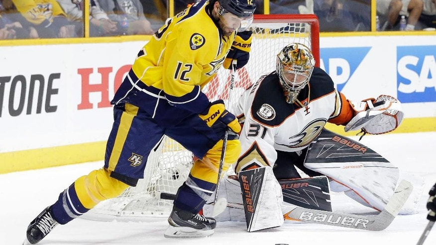 Anaheim Ducks goalie Frederik Andersen (31), of Denmark, watches as Nashville Predators forward Mike Fisher (12) closes in during the second period of Game 3 in an NHL hockey first-round Stanley Cup playoff series Tuesday, April 19, 2016, in Nashville, Tenn. (AP Photo/Mark Humphrey)