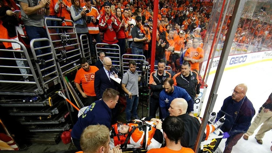 Philadelphia Flyers' Scott Laughton is transported off the ice after an injury during the first period of Game 4 in the first round of the NHL Stanley Cup hockey playoffs against the Washington Capitals , Wednesday, April 20, 2016, in Philadelphia. (AP Photo/Matt Slocum)