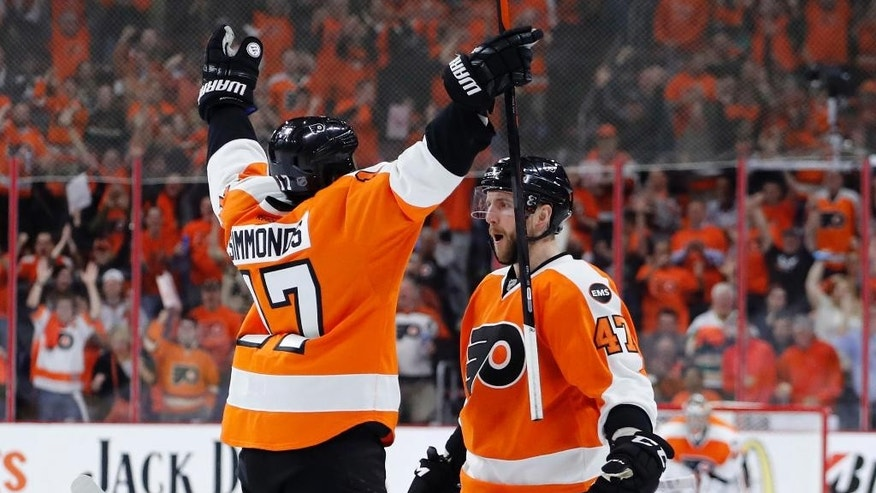 Philadelphia Flyers' Wayne Simmonds, left, and Andrew MacDonald celebrate after MacDonald's goal during the second period of Game 4 in the first round of the NHL Stanley Cup hockey playoffs against the Washington Capitals, Wednesday, April 20, 2016, in Philadelphia. (AP Photo/Matt Slocum)