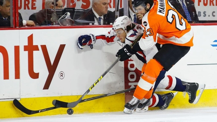 Philadelphia Flyers' Brandon Manning, right, battles for the puck with Washington Capitals' T.J. Oshie during the first period of Game 4 in the first round of the NHL Stanley Cup hockey playoffs, Wednesday, April 20, 2016, in Philadelphia. (AP Photo/Matt Slocum)